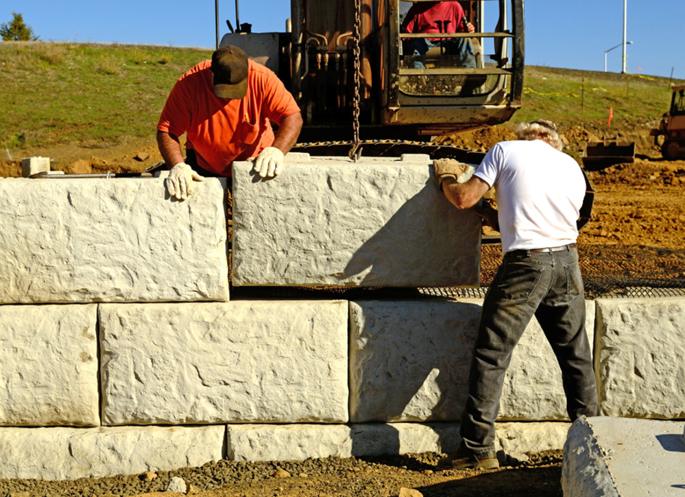 Men installing retaining wall