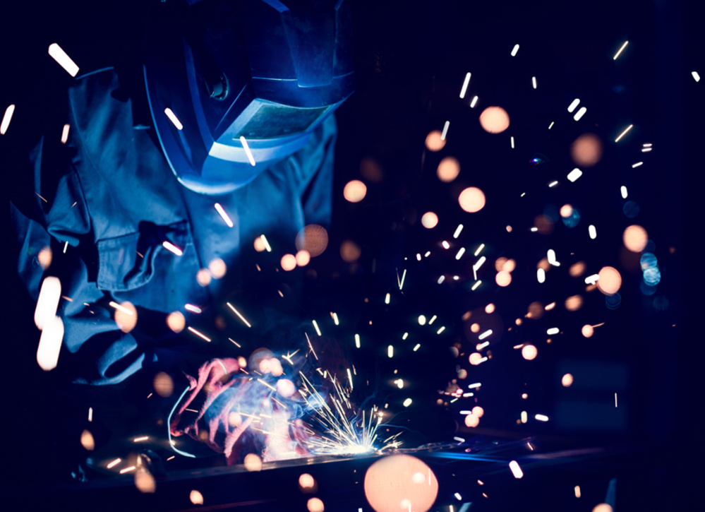Worker Welding in Protective Gear
